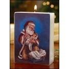 Adoring Santa Candle